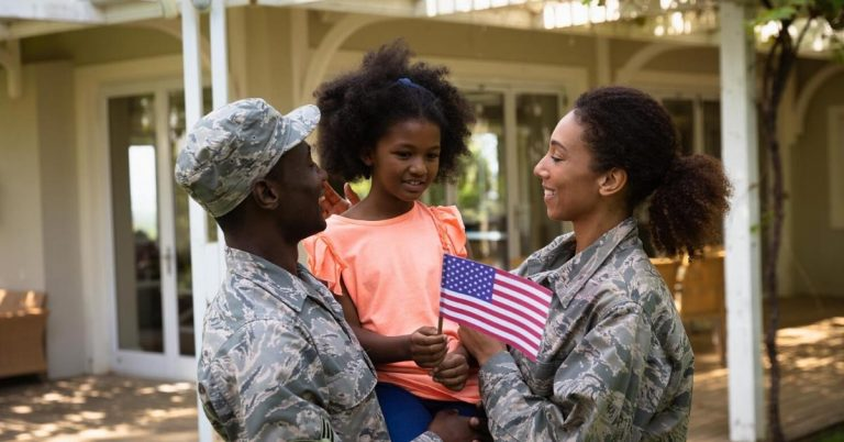 a military family in front of their home