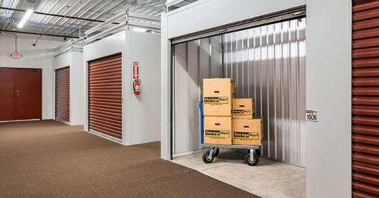 StorageMart boxes in a small indoor unit