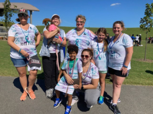 A group picture of Nicole and her friends and family at the Out of the Darkness Walk